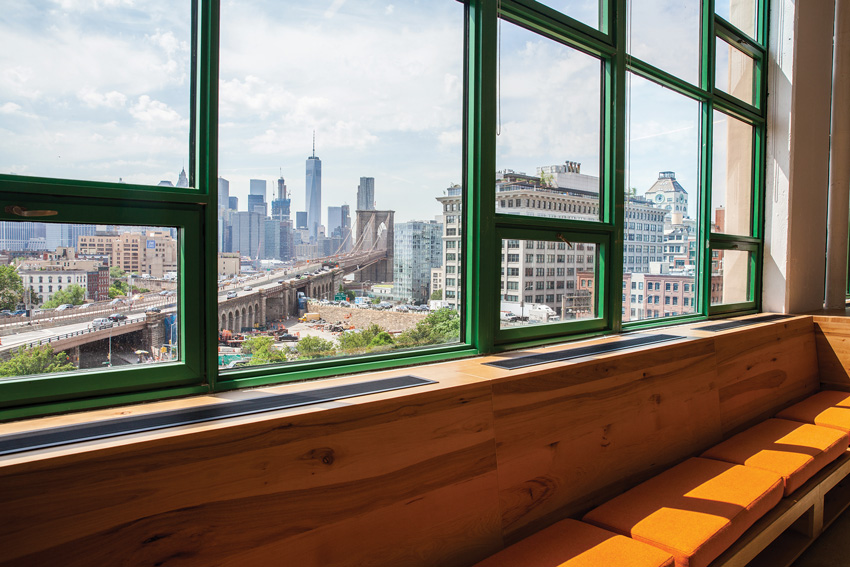 Photo of window with the city in the background.