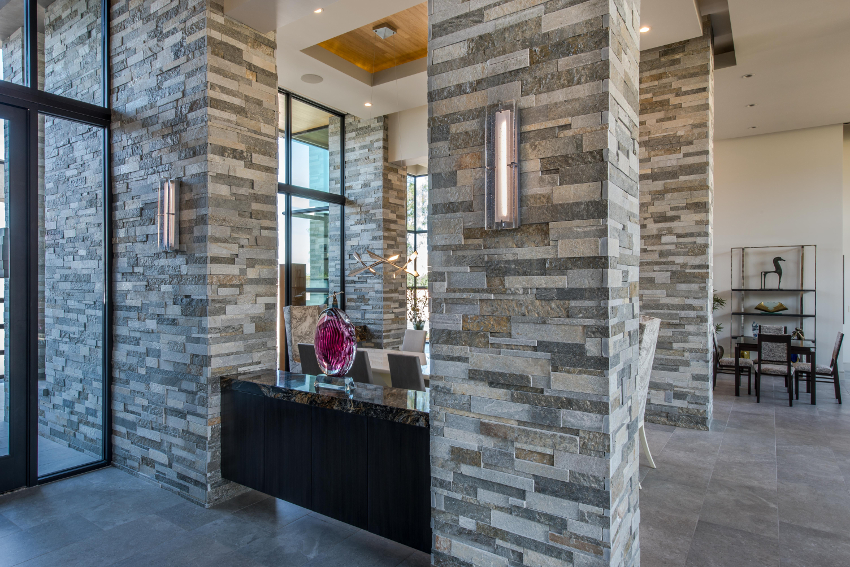 Inside of a building. This charcoal and white quartzite stack stone from Northern Stone Supply was supplied by Arizona Stone