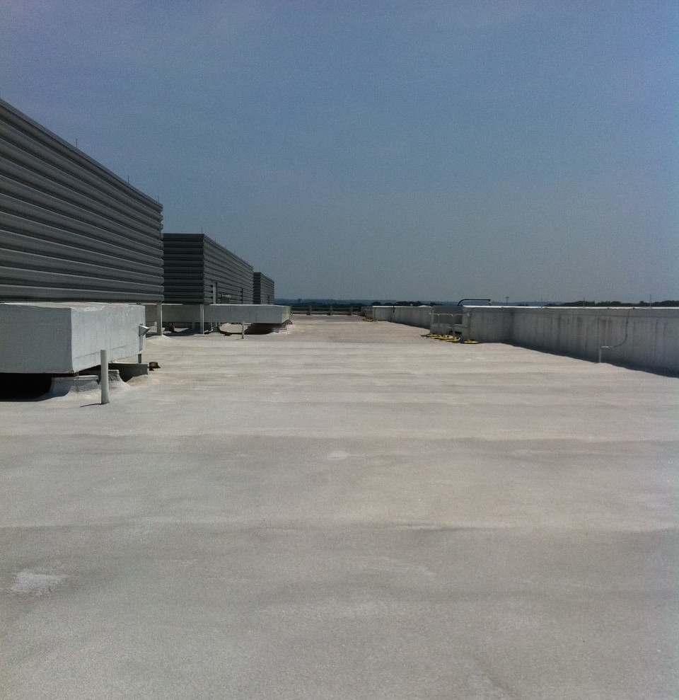 Spray Polyurethane Insulation and Membrane Roofing System