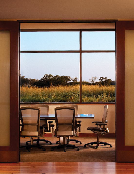 Research is confirming that interiors with natural materials and views, exemplified here in the Greater Texas Foundation in Bryan, Texas, can lower stress and promote relaxation.