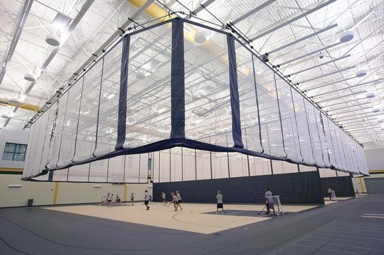 Divider curtains allow a variety of sports to be played inside a gymnasium and protect participants from errant balls.