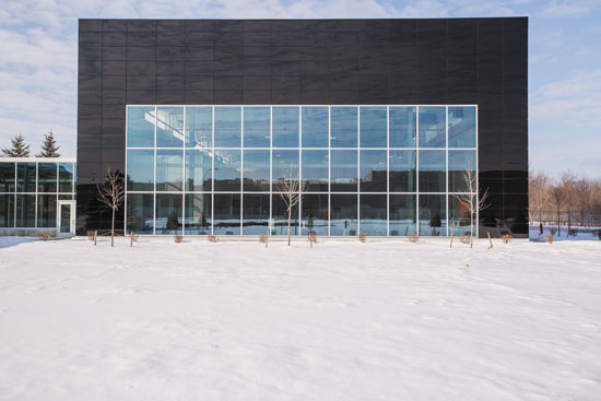 A mix of vision glass and dark spandrel glass is used on the Guardian Science & Technology Center addition and takes advantage of the multiple visual and performance attributes of available glass products.