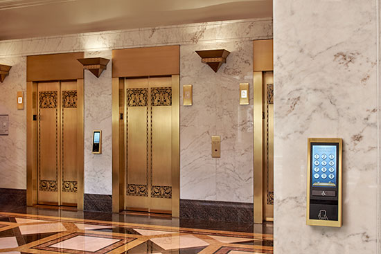 Destination dispatch input devices may be located in the lobby or in the elevator bank.