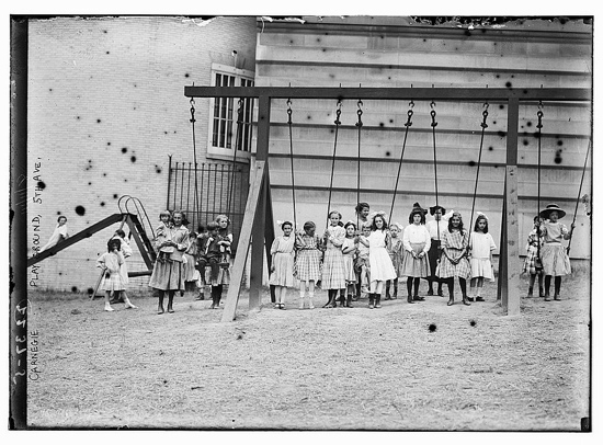 An early North American playground with swings and a slide.