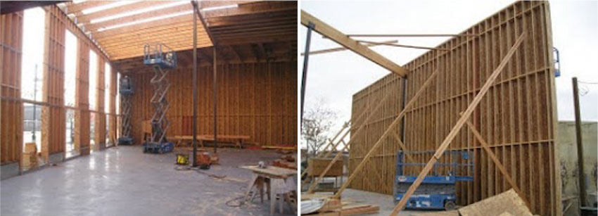 Photo of wood walls being erected.