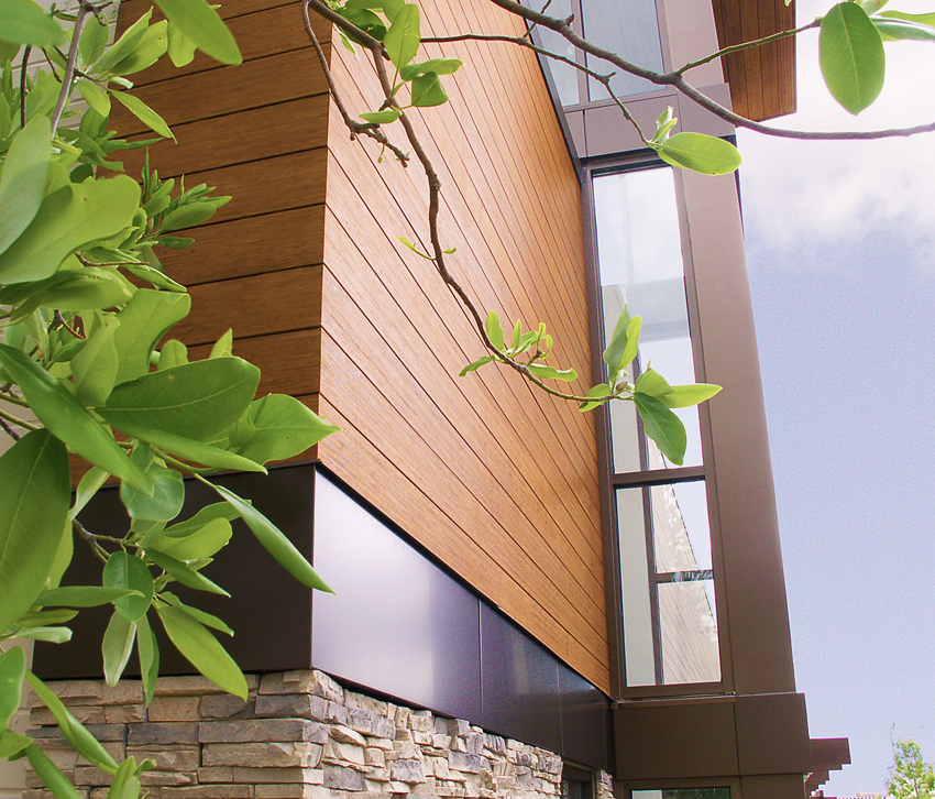 For rainscreens, systems available from fabricators include standard dimensional lumber size slats with pre-engineered corner details and window trim. The LVB panels are hung with clips on predrilled furring strips, with an air space and air/moisture barriers.