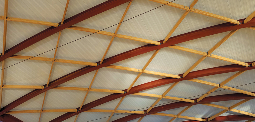 Williamson County Regional Airport terminal project in Marion, Illinois, the A/E firm RS&H has designed a domed roof structure with hybrid steel-and-bamboo cross bracing.