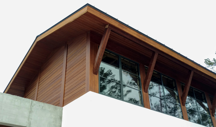 Engineered bamboo products used as rainscreen and structural supports for the overhang