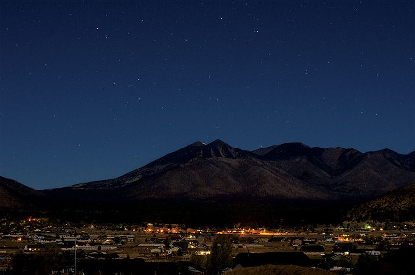 Photo of a town under a night sky.