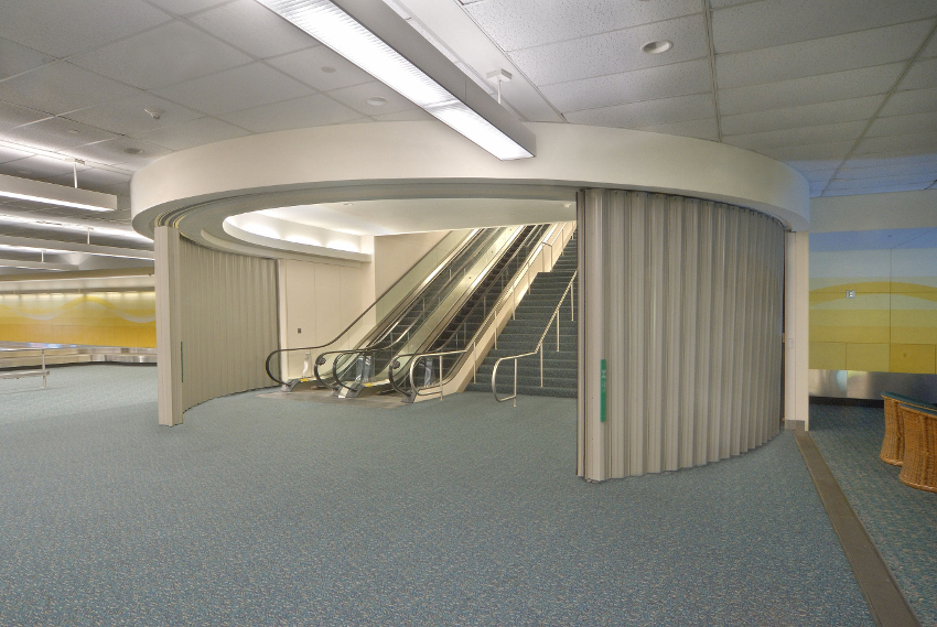Photo of curved sliding fire doors around multistory stairways.