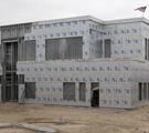 Continuous Insulation for Code-Compliant, High-Performance Walls in Types I-IV Construction