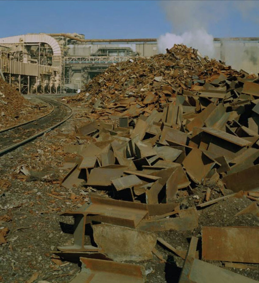 Shown is segregated scrap grades in a scrap storage yard await recycling into structural steel.