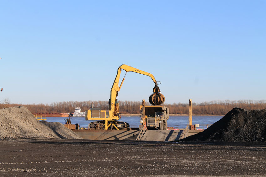 Shown is scrap being transferred from a barge to the scrap yard at Nucor-Yamato steel's (NYS) mill facility.