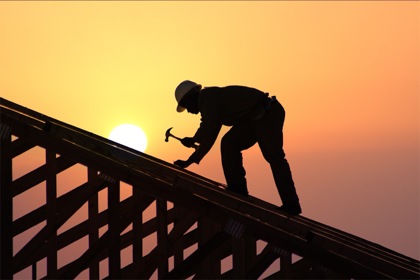 Construction worker on roof.