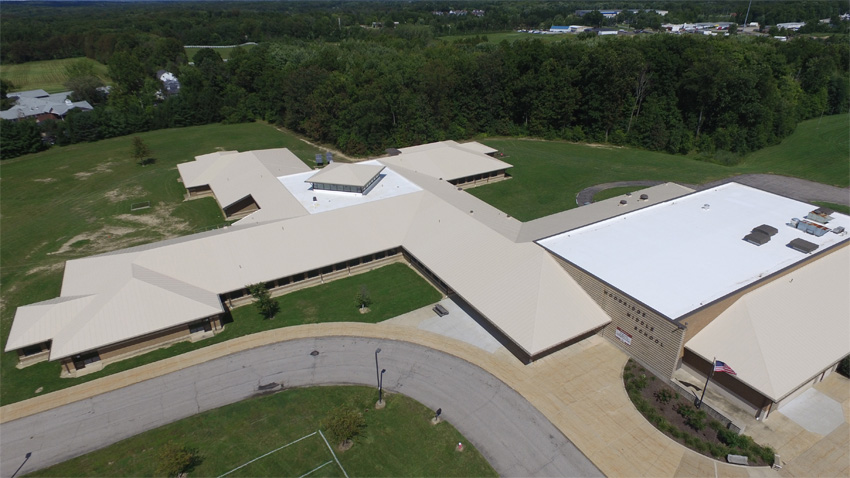 Aerial view of a large building's roof.