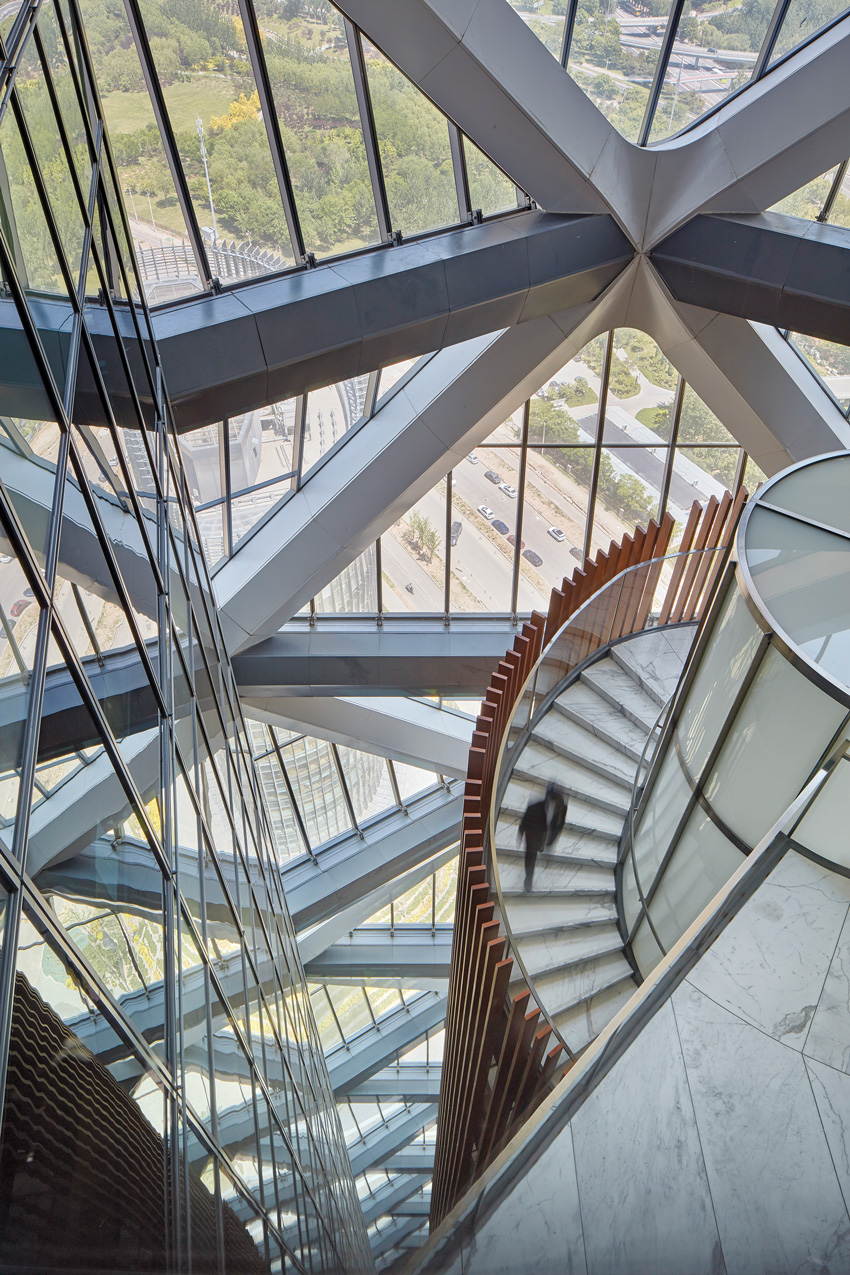 Photo of steel structures inside a building with marble floors.