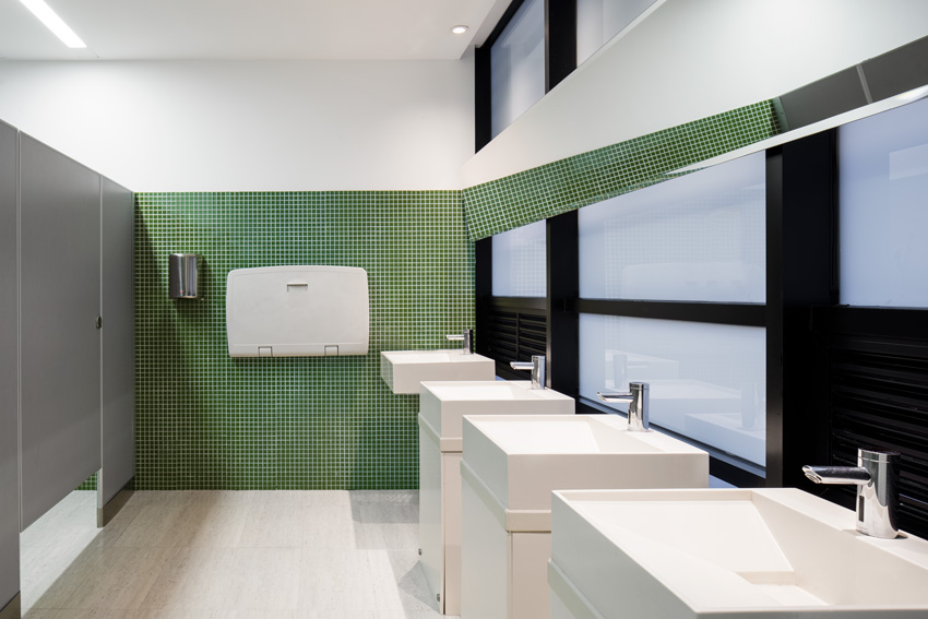 Photo of restroom with automatic sink faucets.