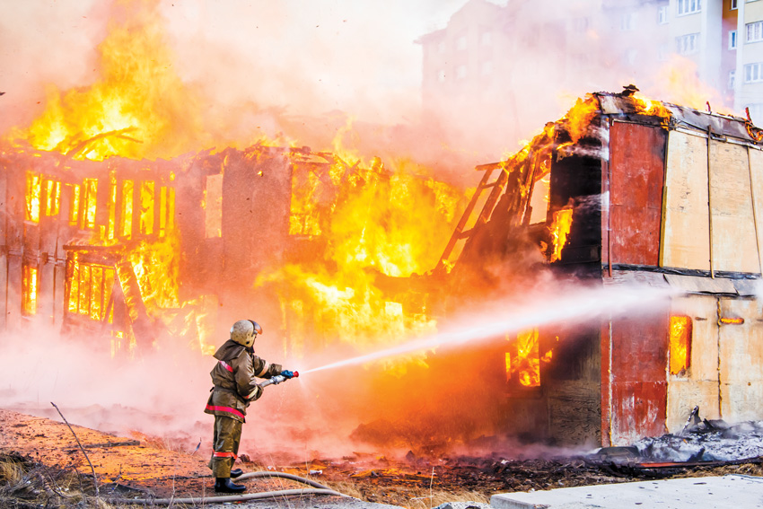 Photo of firefighter putting out a fire