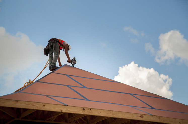 Photo of a roof with structural sheathing with taped seams.