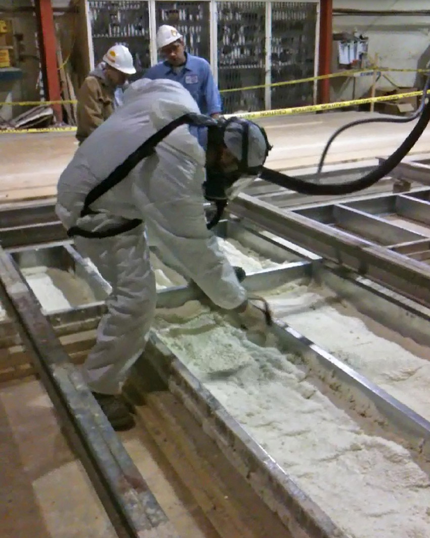 Image of workers sealing factory-applied foam insulation seals any air gaps of a thermal wall system