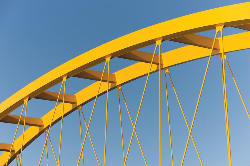 Yellow paint on a bridge arch