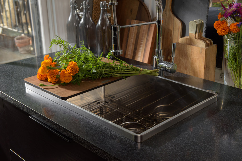 At Miller Residence, there is a sink that has built-in accessories that helps maximize space in the kitchen