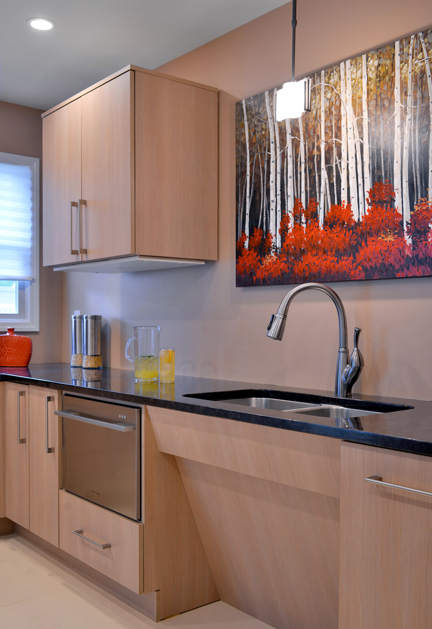 Accessible kitchen design with a sink that is slanted in which is user friendly