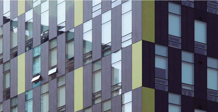 Sintered stone panels mixed with curtail wall system for building facades